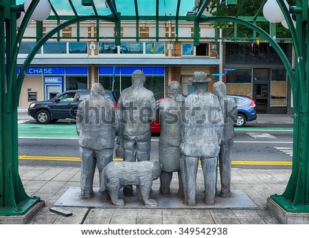 SEATTLE, USA - AUGUST 23, 2015: Modern art sculpture in Freemont district, Seattle. The group of people and the dog on a bus stop. - stock photo