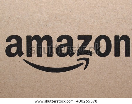 SEATTLE, USA - CIRCA APRIL 2016: Logo of online retailer Amazon on a corrugated cardboard packet used for worldwide shipping - stock photo