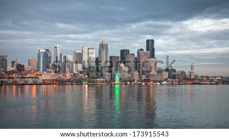 Seattle, USA, JANUARY 2014: Skyline of Seattle in the evening. One office building has its office lights on showing the number 12, supporting the Seahawks for the upcoming match. January 18, 2014