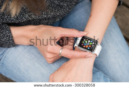 SEATTLE, USA - July 27, 2015: Woman Using Apple Watch. Multiple Apps View. - stock photo
