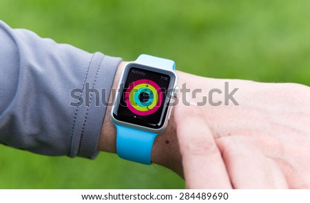 SEATTLE, USA - June 5, 2015: Man Checking Activity App on Apple Watch. Checking Progress and Goals Accomplished.  - stock photo