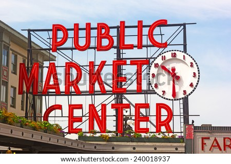 SEATTLE, USA - JUNE 16, 2013: Public Market Center sign in Seattle downtown on June 16, 2013. Pike street market is famous for fresh produce, delicious food and unique arts and crafts.