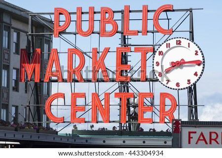 SEATTLE, USA - JUNE 15, 2016: The bright red public market sign marks the main entrance to Seattle's famous Pike Place Market.