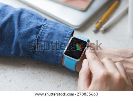 SEATTLE, USA - May 17, 2015: Man Using activity App on Apple Watch to See Calories Burned During Day. - stock photo