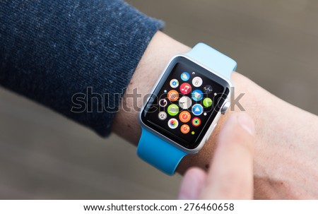 SEATTLE, USA - May 9, 2015: Man Using App on Apple Watch While Outside. Multiple Apps View. - stock photo