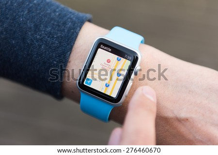 SEATTLE, USA - May 9, 2015: Man Using Maps App on Apple Watch While Outside. - stock photo
