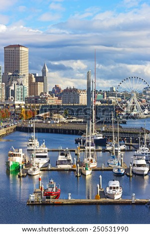 SEATTLE, USA - OCTOBER 26, 2014: City downtown near the pier with anchored yachts, aquarium and Ferris on the late afternoon in Seattle on October 26, 2014. - stock photo