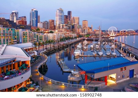 SEATTLE, WA - CIRCA AUGUST 2012. Seattle Downtown and Pier 66 in dusk