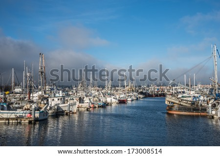 SEATTLE, WA - JANUARY 20, 2013: North Pacific Fishing Fleet and Recreational Craft moored at Fishermen's Terminal, both a working dock and a Seattle tourist attraction, celebrates 100 years in 2014. - stock photo