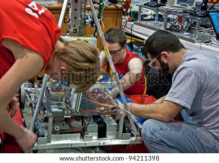 SEATTLE, WA - MARCH 17: unidentified teens compete at a state level competition for science and technology robotics competition. Held on March 17, 2011 in Seattle, WA. - stock photo