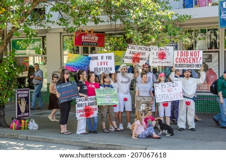 Seattle, WA, USA - July 8, 2014: a group of protesters, demonstraiting agaist circumcision, stand at the corner of Pike St. and First St., near Pikes Place Market, in Downtown Seattle. - stock photo