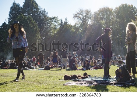 SEATTLE, WA/USA - SEPT 27, 2015: A large crowd gathers at Volunteer Park on a sunny fall day - stock photo