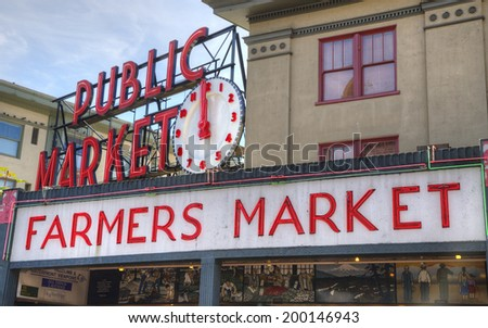 Seattle, Washington - August 30, 2013: Famous Seattle Landmark Pike Place Farmer''s Market, drawing 10 million tourists and residents yearly  to buy from local fishermen, farmers and craftspeople.