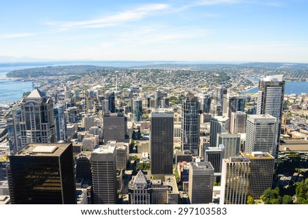 SEATTLE, WASHINGTON - AUGUST 7, 2013: View of the city looking north from the 76th floor of the Columbia Center. The Space Needle is dwarfed by the high-rise office towers in the downtown area.