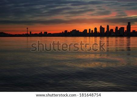 Seattle Washington City Skyline Silhouette at Early Morning Dawn Sunrise Along Puget Sound - stock photo