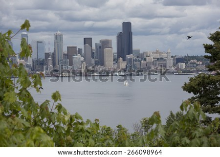 Seattle, Washington Downtown Core of Skyscrapers Looking from West Seattle with Birds Flying and Boats in the Harbor - stock photo