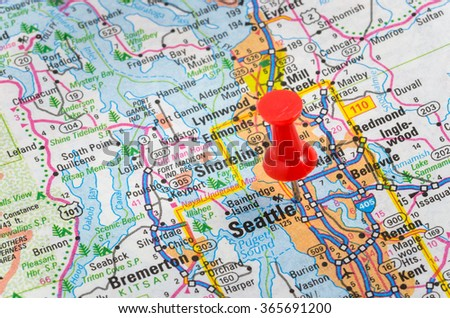 Seattle, Washington, Highlighted with a Pushpin on a Map. Shallow Deep of Field. - stock photo
