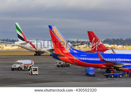 SEATTLE, WASHINGTON STATE, USA - OCTOBER 29, 2015: View to airplanes in the Seattle-Tacoma International Airport.
