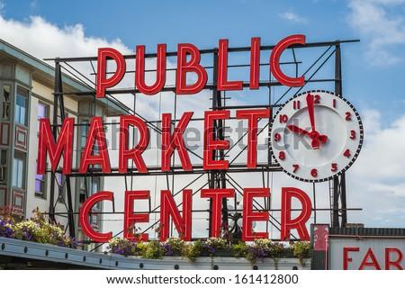 SEATTLE, WASHINGTON/UNITED STATES - SEPTEMBER 2: Neon Public Market Center sign in Pike Place Market in Seattle, Washington on September 2, 2012. - stock photo