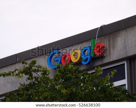 SEATTLE, WASHINGTON/USA - June 24, 2016: Outside View of Google Logo on Office Building with tree in forground in Seattle, Washington.