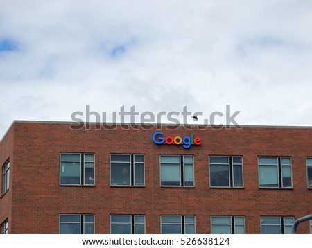 SEATTLE, WASHINGTON/USA - June 24, 2016: Outside View of Google Logo on red brick Office Building with bird in flight in Seattle, Washington