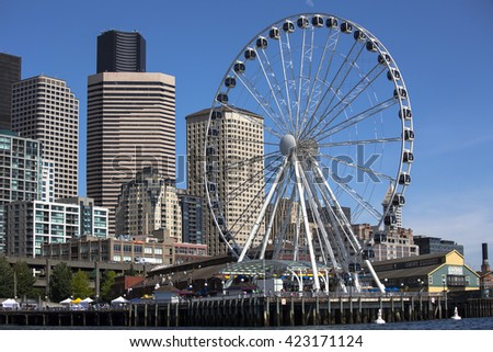 SEATTLE, WASHINGTON/USA - June 6, 2014: Seattle Waterfront District features The Great Wheel as one of its main attractions, the tallest Ferris wheel on the West Coast of the US when it opened in 2012