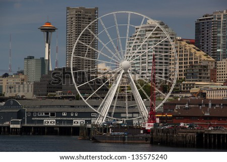 SEATTLE, WASHINGTON,USA - MAY 24: A new ferris wheel is being built along Seattle's waterfront on May 24,2012. The Seattle Great Wheel will be one of the biggest ferris wheels in the United States. - stock photo