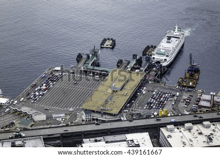 SEATTLE, WASHINGTON/USA - SEPTEMBER 18, 2015: Aerial view of Seattle Ferry Terminal and Alaskan Way Viaduct downtown. The state of Washington has the fourth largest ferry system in the world.