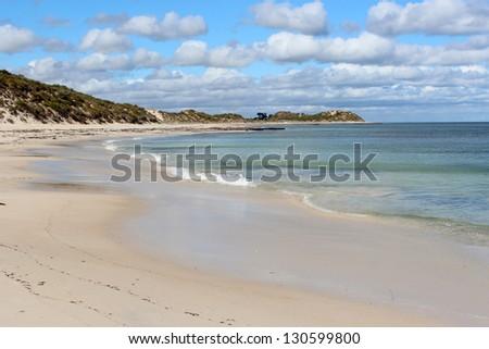 Seaweed covered sandy shore at Hutt's beach near Bunbury western Australia on a cloudy autumn morning. - stock photo