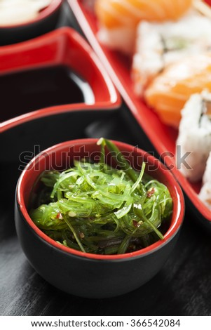 Seaweed salad and sushi assortment - stock photo