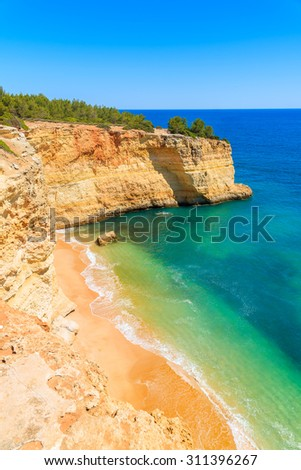 Secluded beach and cliffs on coast of Portugal near Carvoeiro town