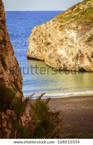 Secluded beach found between two big rocks - stock photo