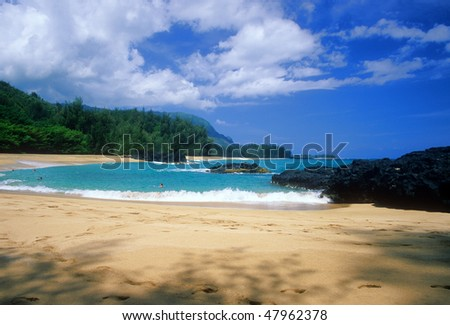 Secluded Lumahai Beach is located on the north shore of Kauai, Hawaii. - stock photo