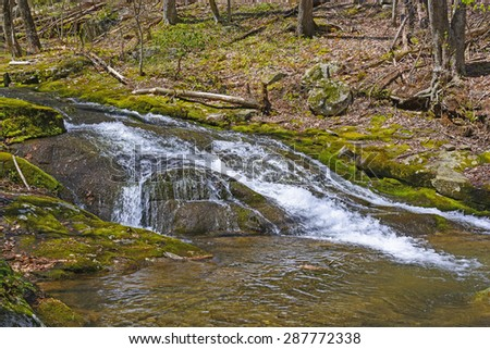 Secluded Mountain Cascade of the Rose River in Early Spring in Shenandoah National Park in Virginia - stock photo