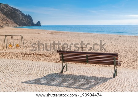 Secluded place for meditations on the sea shore. On a bench near the swing.