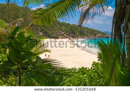Secluded Tropical Beach on La Digue - stock photo