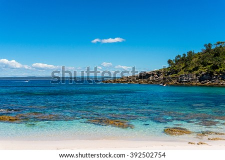 Secluded wild Silica beach in Silica Cove at Beecroft peninsular, NSW, Australia. Turquoise water and white sand tropical beach landscape - stock photo