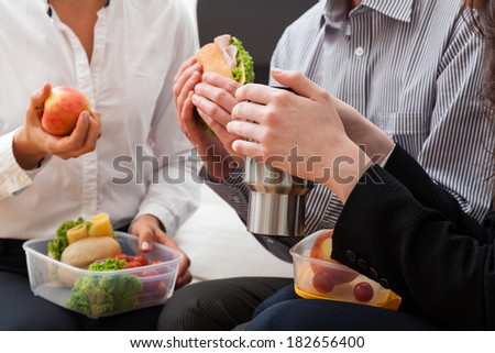 Second breakfast during the break from work in the office - stock photo