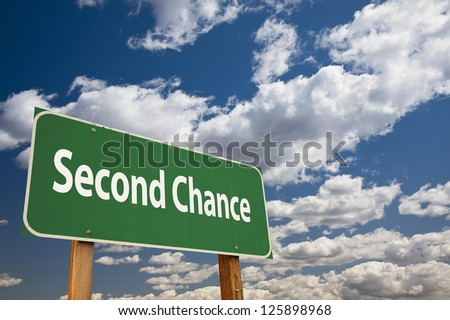 Second Chance Green Road Sign Over Clouds and Sky. - stock photo