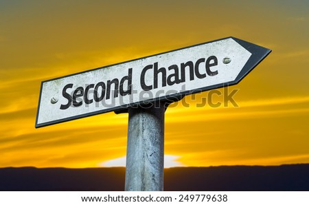 Second Chance sign with a sunset background - stock photo