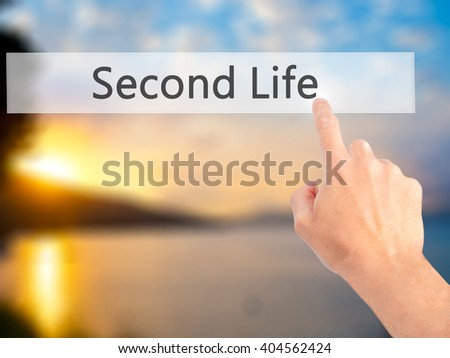 Second Life - Hand pressing a button on blurred background concept . Business, technology, internet concept. Stock Photo