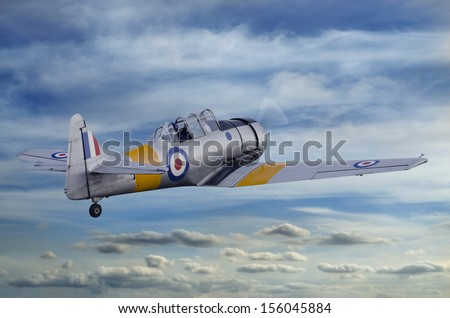 Second World War T6 Harvard Airplane flying into the sky - stock photo