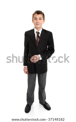 Secondary school student standing in uniform.  White background.  Shadow left under feet. - stock photo