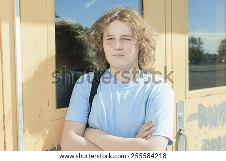 Secondary student on the playground of his school - stock photo