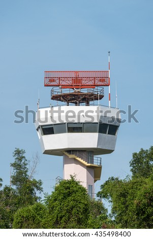Secondary surveillance radar tower for tracking postion of the aircraft behind the trees - stock photo