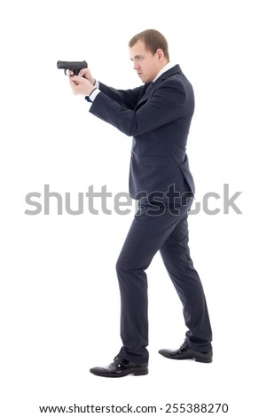 secret agent man in business suit posing with gun isolated on white background - stock photo