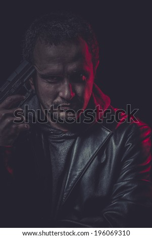 secret agent with gun and red light - stock photo