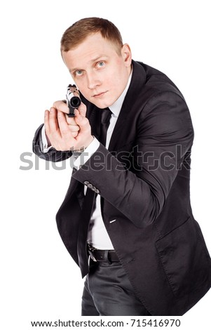 Secret aghent or spy holds pistol with silincer in hand. Isolated on white background.