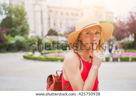 secret concept, finger on the lips, portrait of woman traveling - stock photo