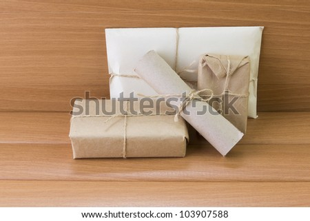 secret letter lying on the boards with a bird's feather. - stock photo